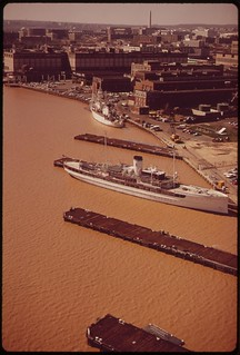 Aerial View Of The Washington Navy Yard And The Anacostia River. Excessive Silt Causes The Brown Color Of The Water, April 1973