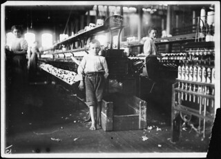 "Leo 48 inches high, 8 years old. Picks up bobbins at 15 cents a day in Elk Cotton Mill. He said, ""No I don't help sister or mother, just myself."" Fayetteville, Tenn, November 1910"