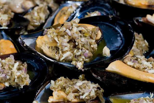 Mussels with grilled garlic scape pesto