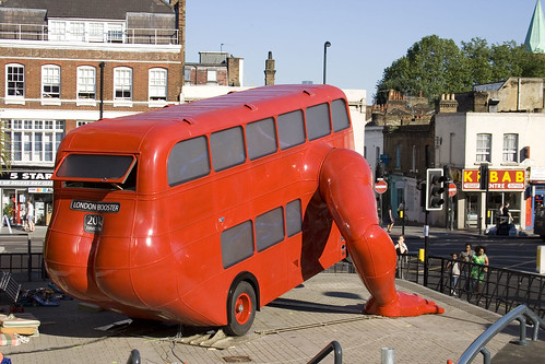 Red bus doing push-ups