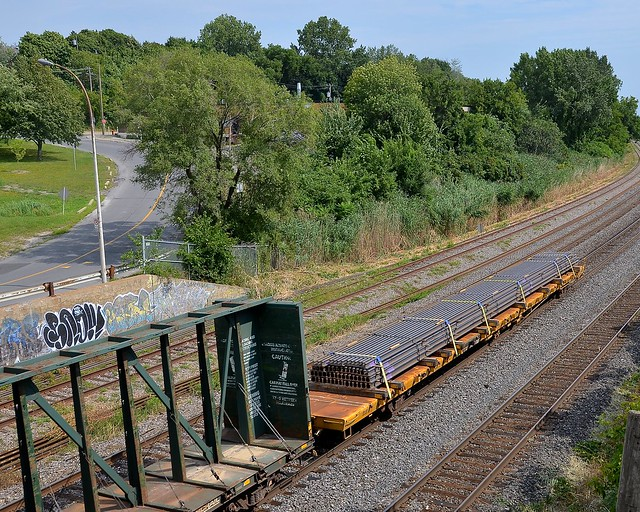 A third flatcar with rail