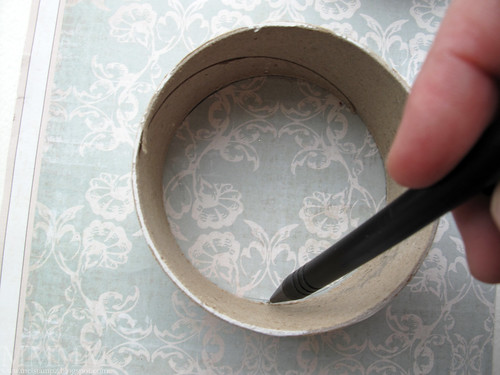 Step 11) Trace the inside of each ribbon spool ring onto the same patterned paper & cut those two circles out