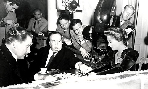 Alfred Hitchcock engrosed in a game of Scrabble by Jack's Movie Mania