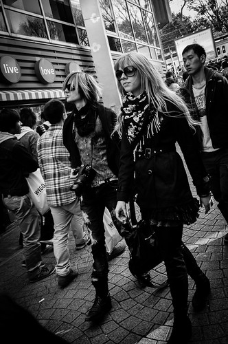 LOOK at us - a trendy couple trapising down Takeshita Street, Harajuku. Tokyo 2012