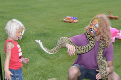 The lion snake tamer amazing a child