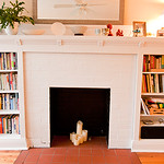 Consider this decorative fireplace a blank canvas, ready for your creative flair.