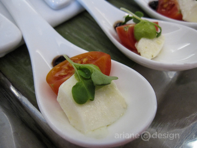 Bocconcini with tomato, sprouts, balsamic reduction