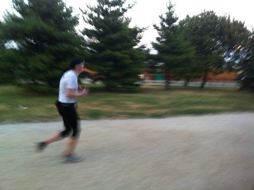 Erica blasting to the finish of the Bastille Day 8K