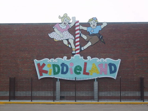 A preserved remnant of the Kiddieland Amusement Park sign on display at the Melrose Park Illinois Public Library building.  July 2012. by Eddie from Chicago