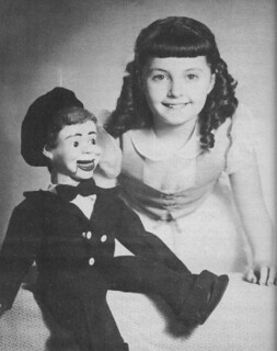 A Young Ventriloquist and her dummy