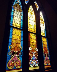 Stained Glass windows in the Remsen church that houses the quilt show. I was too mesmerized by the windows to take any pictures of the quilts! Someday, someone should base a quilt off the design of these windows!