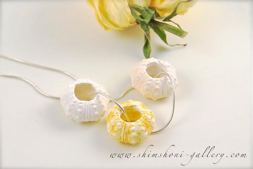 white sea urchin pendant