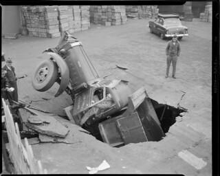 Seven ton dump truck plunges through Warren Avenue bridge behind the Lobster House