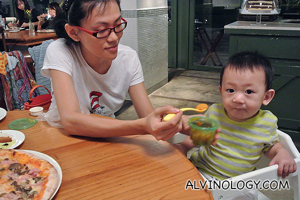 Feeding Asher his puree with bread
