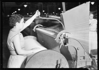 Textiles. Pacific Mills. Barber-Colman High Speed Warper. From front, Operator in act of starting machine, April 1937