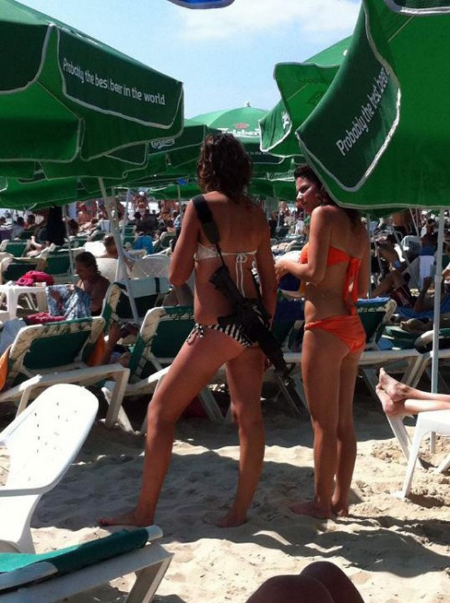Bikini clad Israeli with M-16 in Tel Aviv