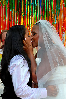 two women kissing at a wedding ceremony