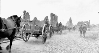 Military transport along a corduroy road built by the Canadian Engineers, during advance East of Arras, France... /  Transport militaire sur un chemin de rondins construit par des ingénieurs canadiens durant l'avancée à l'est d'Arras, en France...