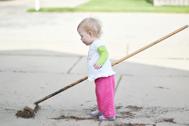 Lucy sweeping outside