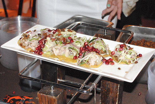 Border Grill pork belly tacos, spicy cabbage slaw, habanero-glazed pork belly, spicy pumpkin seeds, pomegranate seeds