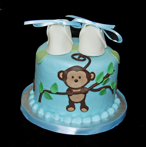 blue green and brown baby shower cupacke tower with monkey hanging from branch