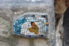 window(0.0), graffiti(0.0), art(1.0), mosaic(1.0), wall(1.0), street art(1.0), blue(1.0),
