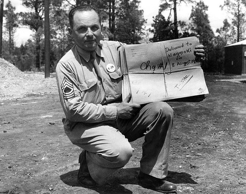 M-Sgt. Gerald Tenney holds envelopes with radiograms of comp