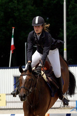 western riding(0.0), dressage(0.0), animal training(0.0), horse harness(0.0), physical exercise(0.0), animal sports(1.0), equestrianism(1.0), english riding(1.0), eventing(1.0), stallion(1.0), show jumping(1.0), hunt seat(1.0), equestrian sport(1.0), rein(1.0), sports(1.0), recreation(1.0), outdoor recreation(1.0), bridle(1.0), equitation(1.0), horse(1.0), jockey(1.0), person(1.0),