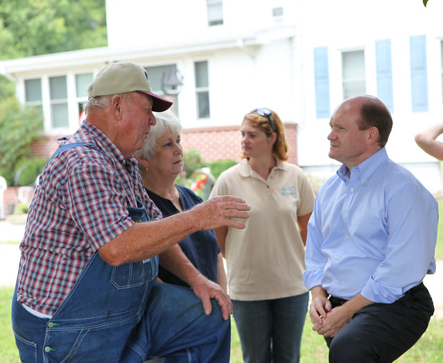Sen. Coons talking to farmer about USDA conservation efforts