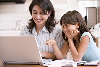 Parent and child browsing on laptop