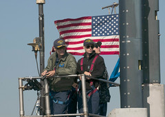 Cmdr. Gary Montalvo, left, and other watch officers man the bridge as USS North Carolina (SSN 777) transits Tokyo Bay in November. (U.S. Navy/MC2 Brian G. Reynolds)