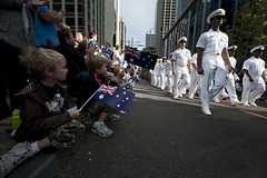 PERTH, Australia (April 25, 2012) Residents wave flags as Sailors assigned to the aircraft carrier USS Carl Vinson (CVN 70) march in the Australia and New Zealand Army Corps (ANZAC) Day parade through downtown Perth. (U.S. Navy photo by Mass Communication Specialist 2nd Class James R. Evans)