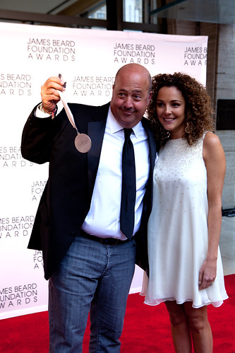 "Andrew Zimmern of ""Bizarre Foods"" dangling his James Beard Award and his wife"