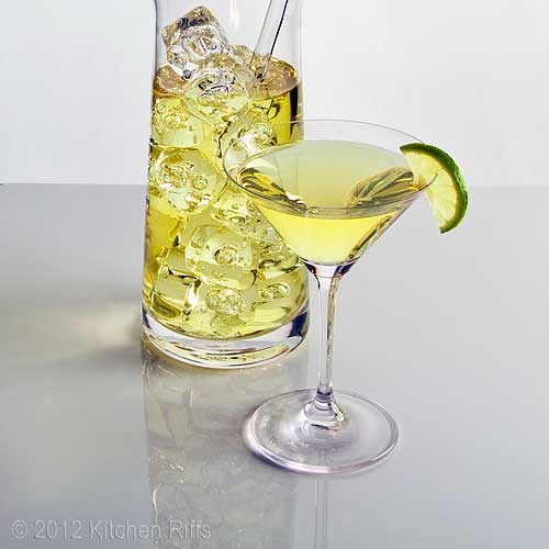 Gimlet Cocktail in Cocktail Glass with Lime Garnish, and Mixing Beaker, Light Background