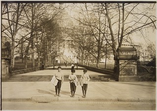 Photograph of a group of news-boys selling on the Capitol steps. Dan Mercurio, a 9 year old chronic truent, began selling when he was 7, April 1912