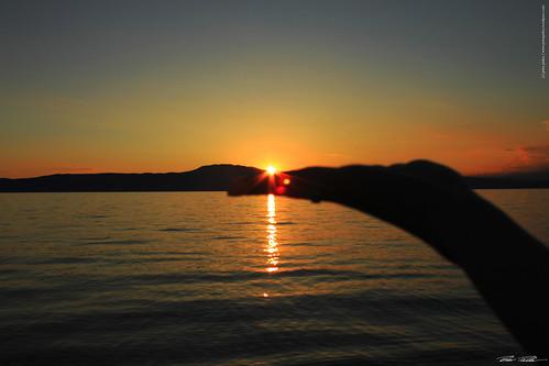 sunset red sea sun rot water canon meer wasser sonnenuntergang hand croatia sonne krk kroatien nivijce peterfoto eos550d peterpirker