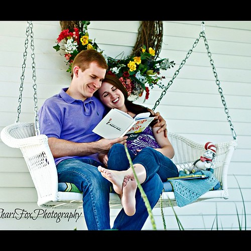 Reading to the babe. #pregnancy #maternity #nate #michelle #swing #porchswing #books #drsuess