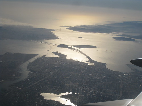 From the airplane, Oakland (below), bay bridge, Golden Gate bridge (distance), downtown San Francisco (upper left, hazy).