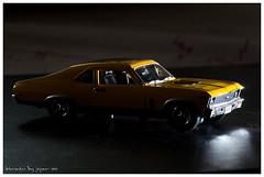 model car(0.0), stock car racing(0.0), automobile(1.0), automotive exterior(1.0), vehicle(1.0), sedan(1.0), land vehicle(1.0), muscle car(1.0), pontiac gto(1.0), sports car(1.0),