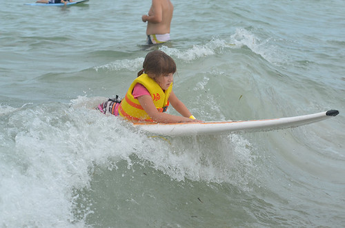 Kid surfing for 1st time at Surfers For #Autism: Returns to Treasure Island, Florida on 7 July 2012
