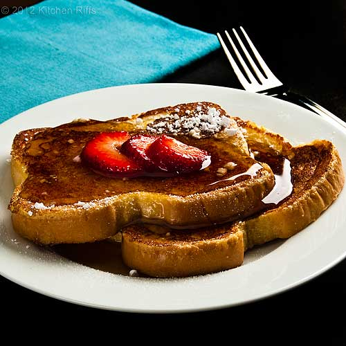 French Toast on Plate with Maple Syrup and Strawberry Garnish