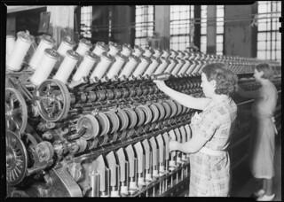 Two women working with machines, March 1937