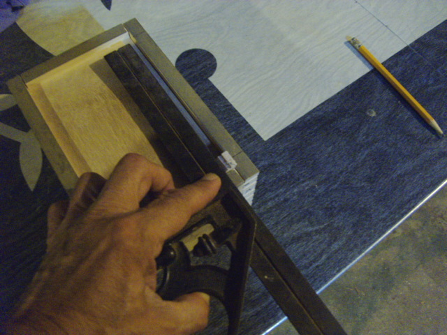 Using a spacer, to mark the ends of the chamfers...