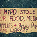 Sign: The NYPD stole our food, medical supplies, personal property and Library