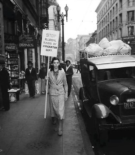 A demonstrator protests immigration raids in Downtown Los Angeles in the 1940s.