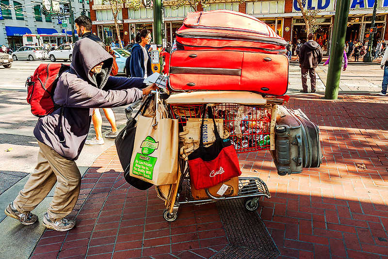 Man-pushing-cart-on-Market-St--San-Francisco-2