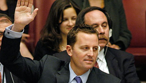 grenell, a white man, raising his hand.