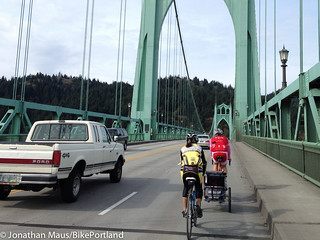 family riding on St Johns bridge
