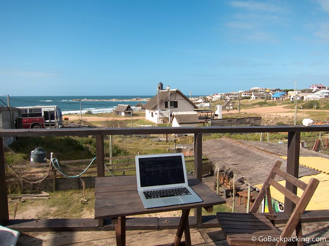 Taking advantage of WiFi, and the view, at a hostel in Punta del Diablo, Uruguay. (photo: David Lee)