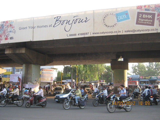 "Hoarding of ""Bonjour"" - 2 BHK Flats at Warje - on the Flyover - Visit Suyog Aura Warje Pune 411052"